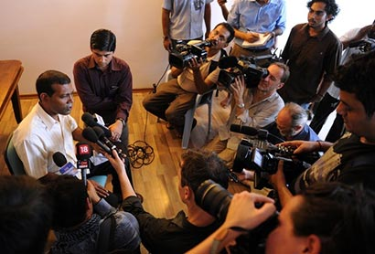Former Maldives president Mohamed Nasheed speaks to reporters in home in Male