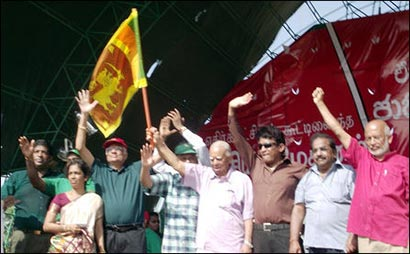 Sambanthan waving lion flag with Ranil Wickramasinghe