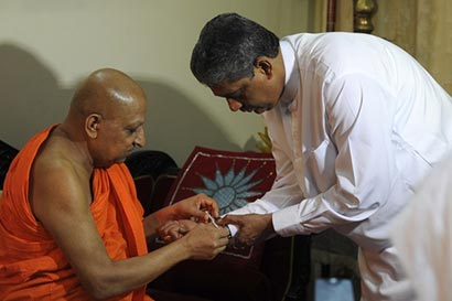 The Chief Incumbent of the Malwathu Chapter Thibbotuwawe Sri Sumangala Mahanayake Thera blesses former Sri Lanka's former army chief Sarath Fonseka