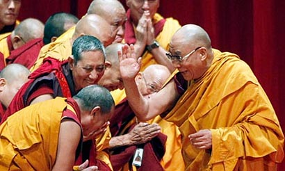 The Dalai Lama greets Buddhist monks