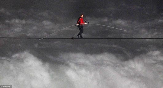Nik Wallenda walks across the Niagara Falls in an attempt to be the first man ever to complete the walk