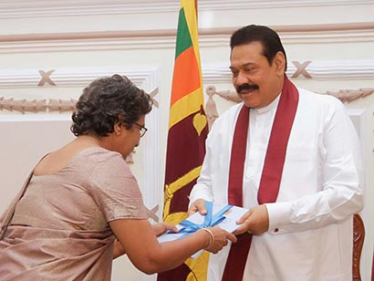 14th Population and Housing Census handed over to President Mahinda Rajapaksa by Superintendent of Census and Director General of Census and Statistics, Mrs Suranjana Vidyaratne at Temple Trees