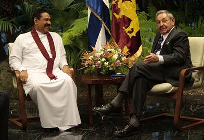 Sri Lanka's President Mahinda Rajapaksa, left, sits with Cuba's President Raul Castro inside Revolution Palace in Havana, Cuba