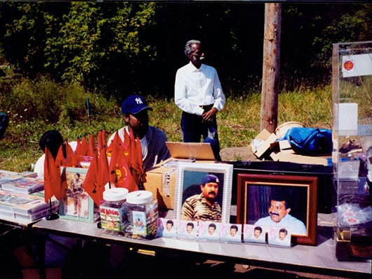 A 2001 file photo shows a donation container and Tamil flags displayed for sale at the renovated Hindu Temple Society in Richmond Hill.