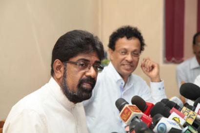 Minister Keheliya Rambukwella with Mr. Ariyaratna Atugala