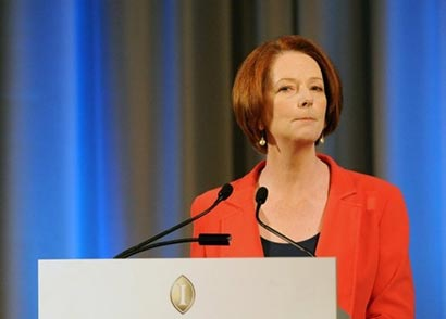 Australian Prime Minister Julia Gillard (pictured on August 7) defended her decision to send asylum-seekers, arriving by boat, to Pacific islands, saying it was a 'tough' policy but could save lives