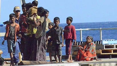 Refugees from Sri Lanka arrive for processing at Christmas Island last month