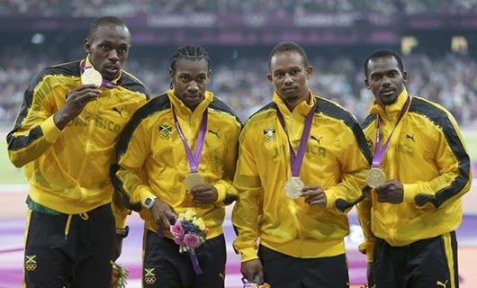 Usain Bolt, Yohan Blake, Michael Frater and Nesta Carter of Jamaica celebrate after winning gold and setting a new world record of 36.84 during the Men's 4 x 100m Relay Final on Day 15 of the London 2012 Olympic Games at Olympic Stadium on August 11, 2012 in London, England.