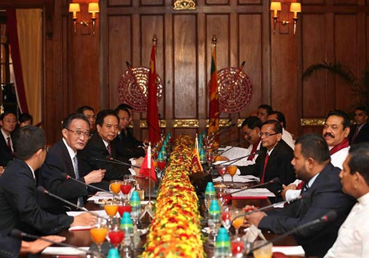 Mr. Wu Bangguo, chairman of the Standing Committee of China's National People's Congress, and Sri Lankan President Mahinda Rajapakse