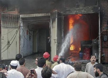 Pakistan factory fires kill 125 workers