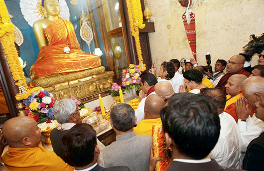 President Rajapaksa visits Bodh Gaya, India amid protests