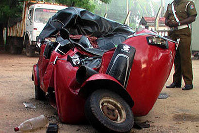 Three dead after three-wheeler collides with truck