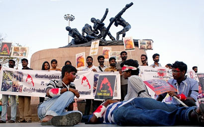 Members of the Students' Federation of India staging a silent protest for the cause of Lankan Tamils near Labour Statue on the Marina Beach