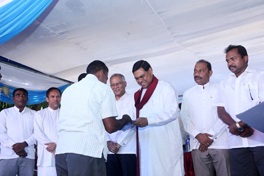 Basil at Indian housing project inauguration ceremony