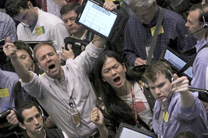 A file photo of traders working at the crude oil options pit at the New York Mercantile Exchange in New York.