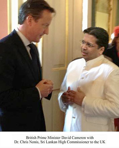 BRITISH PRIME MINISTER CAMERON WITH DR CHRIS NONIS