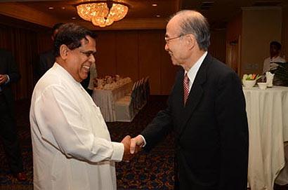 Minister Nimal Siripala De Silva with Yasushi Akashi