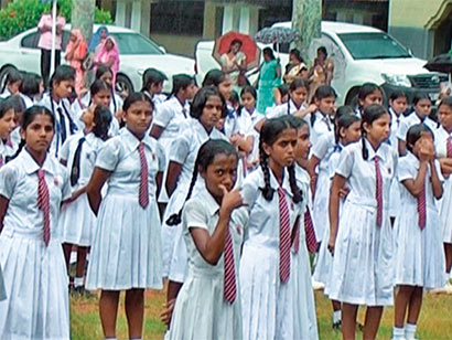Students of Ibbagamuwa Central College were made to listen to a speech by Minister of Education, Bandula Gunawardena, whilst standing outdoors during heavy rain.