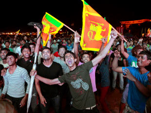 Sri Lanka cricket fans celebrate in Colombo during the T20 world championship team's victory procession