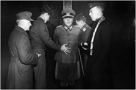 German Wehrmacht General Anton Dostler is tied to a stake before his execution
