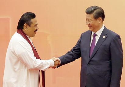 Chinese President Xi Jinping met Sri Lanka President Mahinda Rajapaksa at welcome banquet for CICA dignitaries