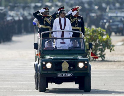 Sri Lanka's President Mahinda Rajapaksa (in white) takes part in a War Victory parade in Matara May 18, 2014