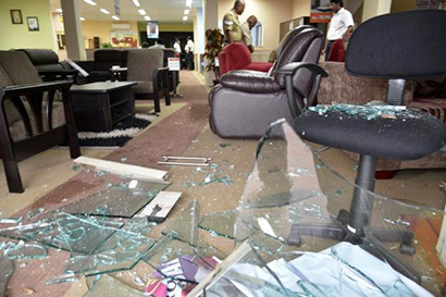 The windows of a showroom dealing in Sri Lankan furniture in Coimbatore were damaged in stone-throwing on Friday