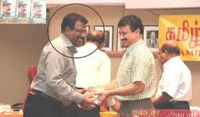 CTC's National Spokesperson David Poopalapillai receiving Prabhakaran's biography