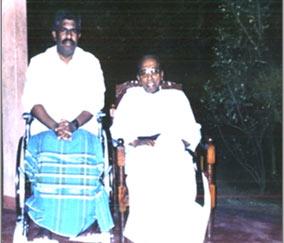 Fr. Emmanuel sitting next to castro