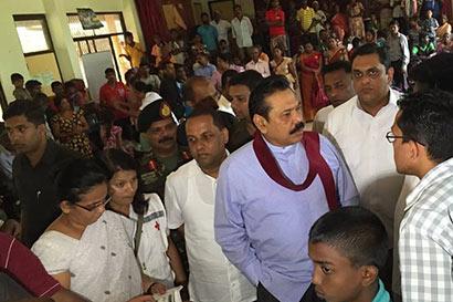 Sri Lanka President Mahinda Rajapaksa inspects landslide victims