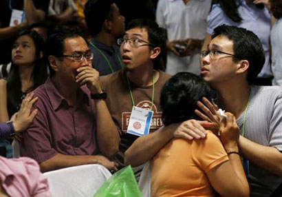 Bodies, debris from missing AirAsia plane pulled from sea off Indonesia