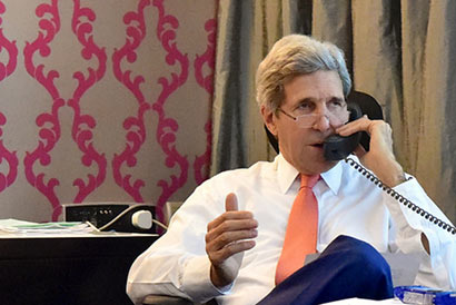 John Kerry over the phone