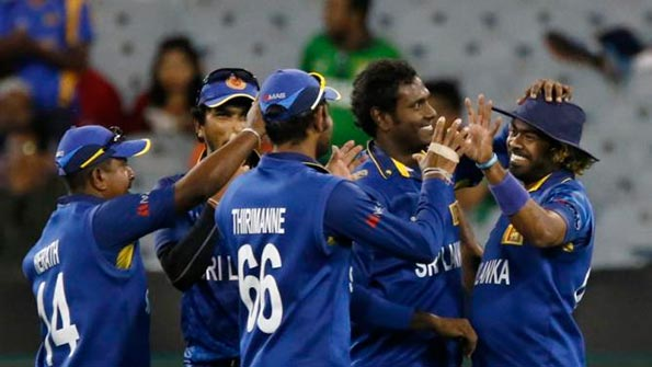 Sri Lanka's Lasith Malinga (R) celebrates with Cricket team mates