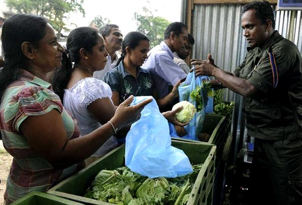 Sri Lanka Army soldier selling vegitable