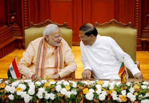 India's Prime Minister Narendra Modi talks to Sri Lanka's President Maithripala Sirisena