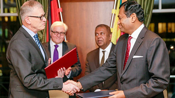 Karunatilake Amunugama signs agreement with Germany