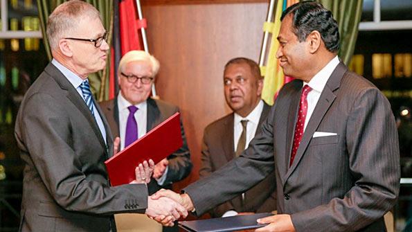 Karunatilake Amunugama signs agreement with Germany