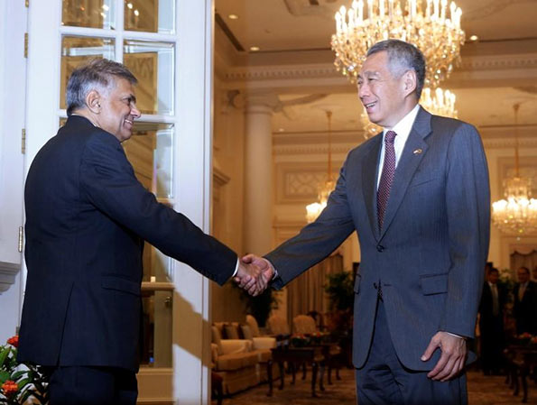 Sri Lanka's Prime Minister Ranil Wickremesinghe shakes hands with Singapore's Prime Minister Lee Hsien