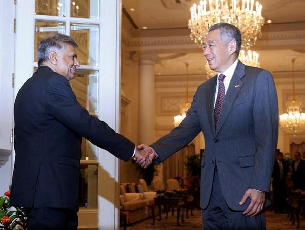Sri Lanka's Prime Minister Ranil Wickremesinghe shakes hands with Singapore's Prime Minister Lee Hsien