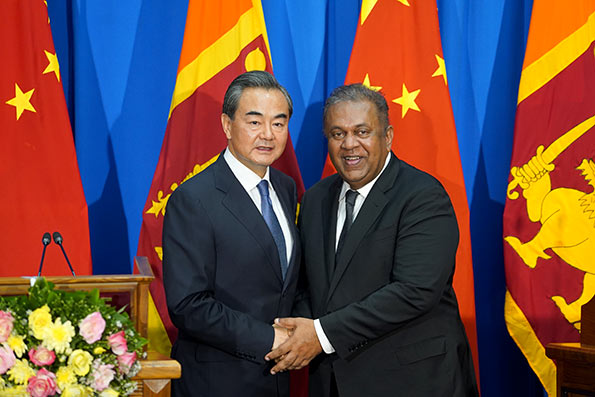 China's Foreign Minister Wang Yi with Sri Lanka Foreign Minister Mangala Samaraweera