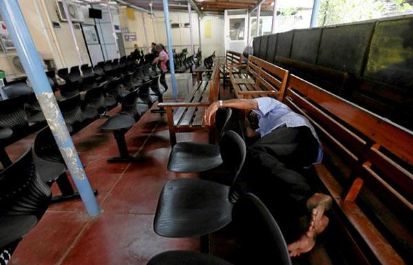 A patient sleeps on a chair in Colombo Sri Lanka