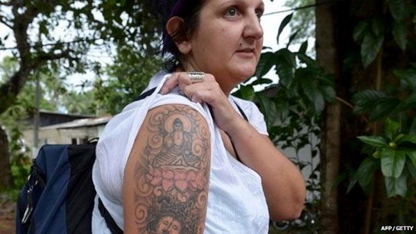 British lady with Buddha tattoo