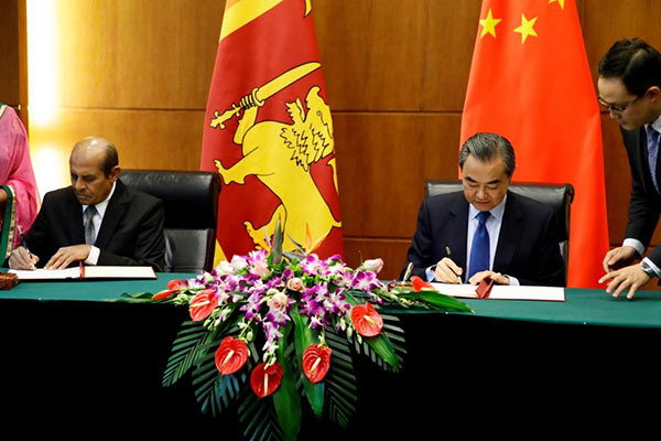 Sri Lanka's Foreign Minister Tilak Marapana and Chinese Foreign Minister Wang Yi