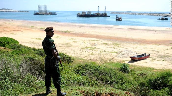 A Sri Lankan commando stands guard on the Hambantota construction site