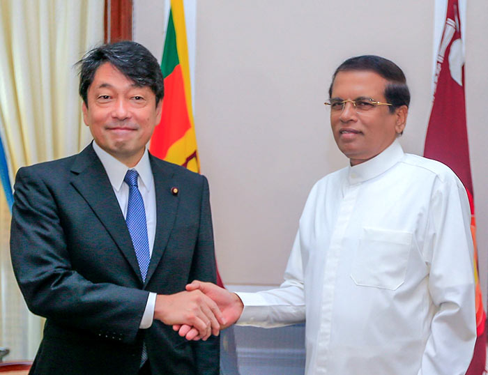 Japan's defence minister Itsunori Onodera with Sri Lanka President Maithripala Sirisena