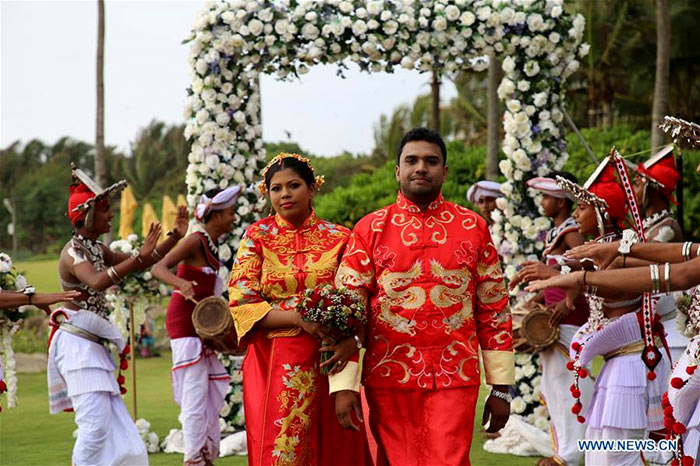 Sri Lankan and Chinese couples are seen during the mass wedding ceremony in Negombo, Sri Lanka