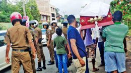 Youths carrying the victim's coffin near Athurugiriya town