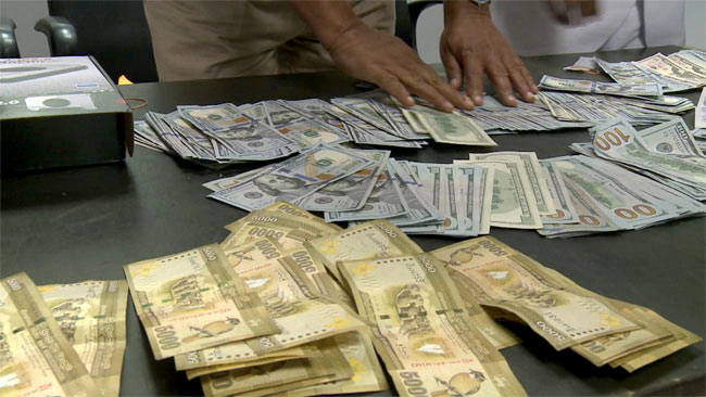 Sri Lankan Passenger apprehended for foreign currency concealed in computer parts