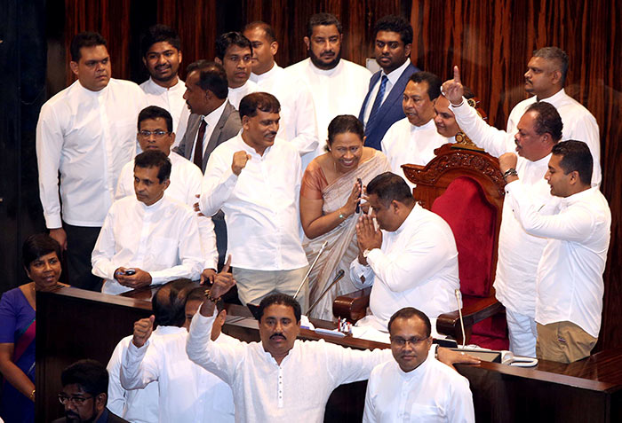 Arundika Fernando sits on the Speaker's chair in Parliament of Sri Lanka
