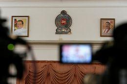 Mahinda Rajapaksa and Sri Lanka President Maithripala Sirisena's photographs on a wall